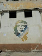 A good friend's travel photo of the ubiquitous face of Che Guevara on the wall of a house in Cuba