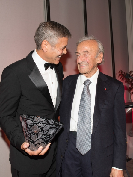 Clooney with his Arts for Humanity Award and Elie Wiesel in May this year photo from http://eliewieselfoundation.org/artsforhumanity.aspx
