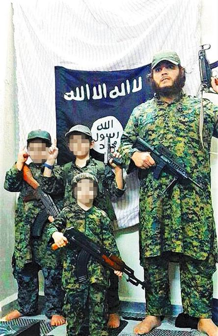 Daily Telegraph (they say supplied) photo of  Khalid Sharrouf with his 3 sons http://www.dailytelegraph.com.au/news/nsw/khaled-sharroufs-sevenyearold-son-from-school-dressup-to-a-child-of-war/story-fni0cx12-1227022431368?nk=6bc290ad69fdfdf5a6b50e63bebdac94