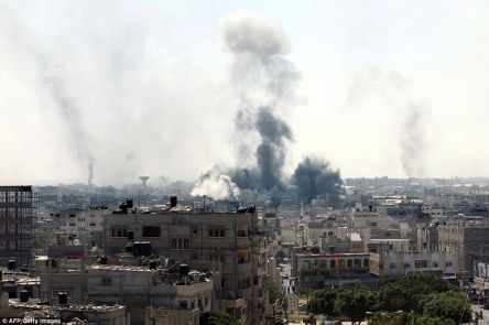 Rafah 2hrs into the ceasefire. Smoke billows from buildings following Israeli military strikes near Rafah in the Gaza Strip that killed at least eight people two hours into a three-day ceasefire Read more: http://www.dailymail.co.uk/news/article-2712656/Israel-Hamas-agree-72-hour-humanitarian-ceasefire-starting-morning.
