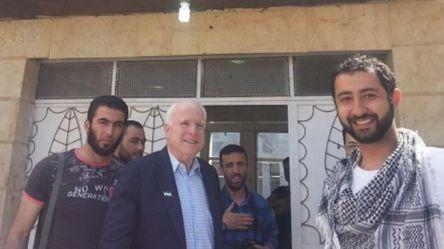 US Senator John McCain photographed with Mohamed Nour and Abu Bakr Al Baghdadi