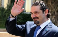 Former Prime Minister Saad Hariri gestures upon his arrival at the Grand Serail in Beirut, Friday, Aug 8, 2014. (The Daily Star/Dalati Nohra, HO