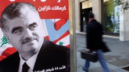 A man walks past a poster depicting Lebanon's assassinated former prime minister Rafik al-Hariri, in downtown Beirut: Reuters