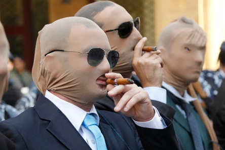 Demo in Beirut -  Lebanese activists dressed as politicians smoke cigars with their heads covered in stockings during a demonstration against the extension of parliament, near the parliament building, downtown Beirut, Oct. 1, 2014. Read more: http://www.al-monitor.com/pulse/galleries/day;jsessionid=6C53900A5E9562F57F639A7ADF9BEE4F?displayTab=demo-in-beirut#ixzz3F91sMobp