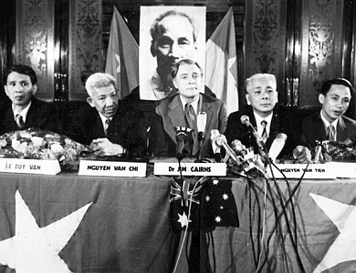 North Vietnamese Delegation April 26, 1973, with government minister Dr Jim Cairns (centre)  in the Sydney Town Hall (whose visit to Australia he sponsored),  replete with Viet Cong flags and a picture of  'Uncle' Ho (Chi Minh).